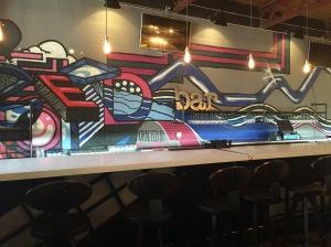 "The bar...graffiti spells out ""Street Food"""