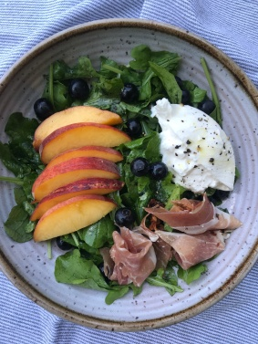 Arugula with peaches, blueberries, pancetta and burrata